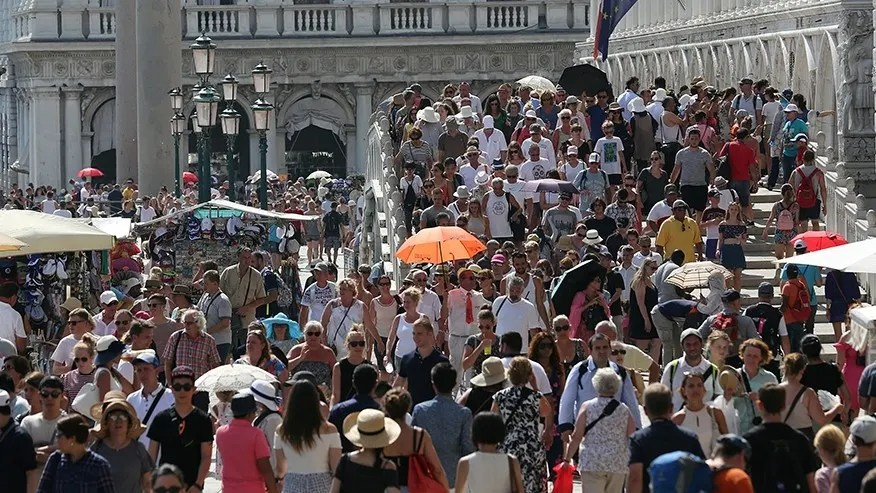 Aug. 3, 2017: Tourists walk near St. Mark's Square in Venice, Italy.