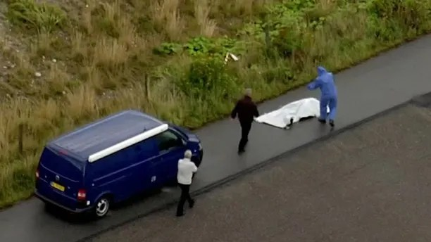 In this image taken from video on Monday Aug. 21, 2017, shows police forensic investigators as they prepare to move a headless body of a woman that was found near Amager Denmark in the Baltic Sea where a missing Swedish journalist is believed to have died on a privately built submarine earlier this month . The headless torso found on a beach near Amager has been identified as that of missing Swedish journalist Kim Wall, Danish police said Wednesday Aug. 23, 2017. (TV2 via AP)