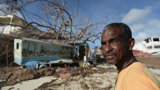 Juan Antonio Higuey shows his destroyed home at Cold Bay community after the passage of Hurricane Irma, in St. Martin, Monday, September 11, 2017. Irma cut a path of devastation across the northern Caribbean, leaving thousands homeless after destroying buildings and uprooting trees.  (AP Photo/Carlos Giusti)