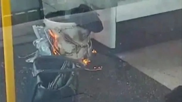 FILE - This is a Friday, Sept. 15, 2017  file photo of an image made from video showing burning items in underground train at the scene of an explosion at Parsons Green station in London. An explosion at Parsons Green train station sent commuters stampeding in panic, injuring several people at the height of London's morning rush hour. London's police chief Cessida Dick said Friday Sept 22, 2017 that the bomb that failed to detonate last week in a London subway car at Parsons Green was loaded with explosives and shrapnel. (Sylvain Pennec via AP, File)