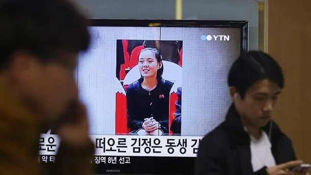 """FILE - In this Nov. 27, 2014 file photo, a TV news program shows a photo of Kim Yo Jong, North Korean leader Kim Jong Un's younger sister, at Seoul Railway Station in Seoul, South Korea. The alleged murder of North Korean leader Kim Jong Un's estranged half-brother could be the best cloak-and-dagger thriller North Koreans will never get to hear. It is simpler to keep the line of succession and power as clear and direct as possible. Kim Yo Jong is a powerful member of the ruling elite. The letters read """"Kim Jong Un's sister."""" (AP Photo/Ahn Young-joon, File)"""