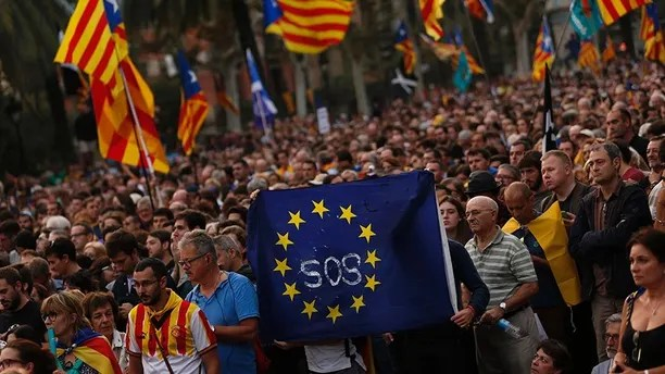 Pro-independence supporters hold a European Union flag during a rally in Barcelona, Spain, Tuesday, Oct. 10, 2017. Catalan President Carles Puigdemont said during his speech in the parliament that the region remained committed to independence but said it should follow dialogue with the government in Madrid. ((AP Photo/Francisco Seco)
