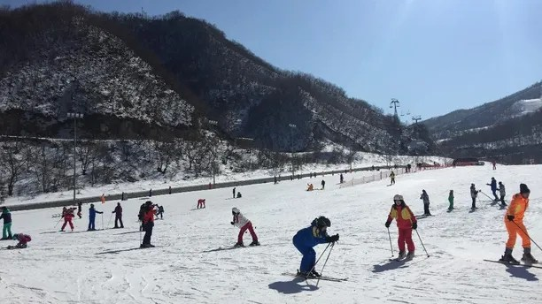 """In this Saturday Feb. 11, 2017, photo, North Koreans ski at the Masik Pass Ski Resort in Wonsan, North Korea. North Korea's Olympic committee lashed out Monday, Feb. 13, 2017, against sanctions over its nuclear and long-range missile programs, claiming they are aimed at hurting the North's efforts to compete in international sports. Sanctions that block the sale of such items as skis, snowmobiles, snow groomers, yachts and even billiard tables are a """"vicious ulterior political scheme,"""" according to its National Olympic Committee. (AP Photo/Wong Maye-E)"""