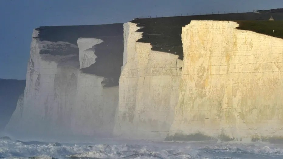 A 23-year-old exchange student from South Korea fell to her death while posing for a photo on the Seven Sisters cliffs.