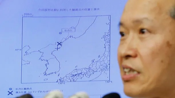 Japan Meteorological Agency's earthquake and tsunami observations division director Toshiyuki Matsumori speaks in front of a screen showing the seismic event that was indicated on North Korea and observed in Japan, during a news conference at the Japan Meteorological Agency in Tokyo, Japan, September 3, 2017, following the earthquake felt in North Korea and believed to be a nuclear test. REUTERS/Toru Hanai - RC19ECC1F430