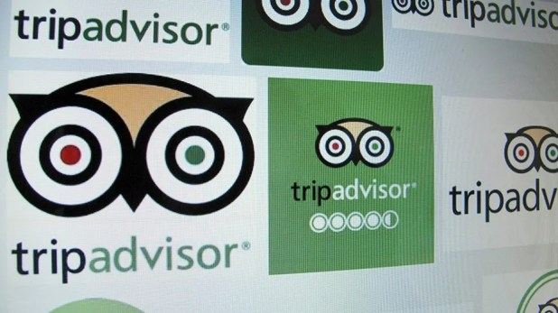 Logos of the travel website Tripadvisor.
