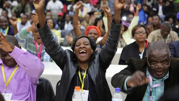 Members of the Zanu pf Central committee react after the ruling party fired President Robert Mugabe, in Harare, Sunday Nov, 19, 2017.  Zimbabwe's ruling party Central Committee fired longtime President Robert Mugabe as party leader Sunday, saying that if he doesn't resign as the country's president by noon Monday they will begin impeachment proceedings when Parliament resumes the following day. (AP Photo/Tsvangirayi Mukwazhi)