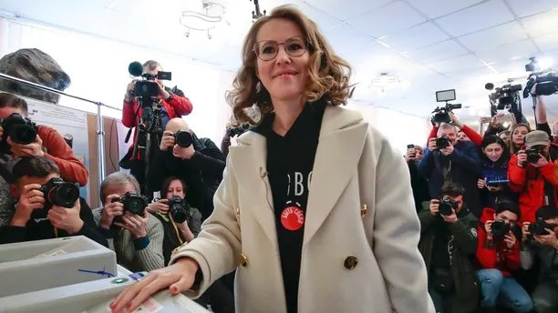 Russian Presidential candidate Ksenia Sobchak casts her ballot for the Russian presidential election, in Moscow, Russia, Sunday, March 18, 2018. Russians are voting in a presidential election in which Vladimir Putin is seeking a fourth term in the Kremlin. (AP Photo/Denis Tyrin)