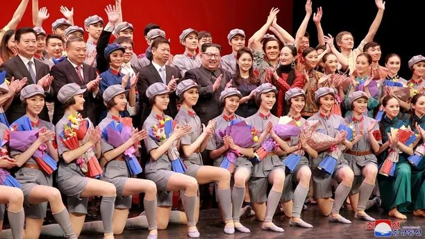 North Korean leader Kim Jong Un, his wife Ri Sol Ju and Song Tao, head of the International Department of Communist Party of China (CPC) Central Committee, applaud with ballet dancers in this undated photo released by North Korea's Korean Central News Agency (KCNA) in Pyongyang April 17, 2018. KCNA/via Reuters  ATTENTION EDITORS - THIS IMAGE WAS PROVIDED BY A THIRD PARTY. REUTERS IS UNABLE TO INDEPENDENTLY VERIFY THIS IMAGE. NO THIRD PARTY SALES. SOUTH KOREA OUT.     TPX IMAGES OF THE DAY - RC1F8E3538B0