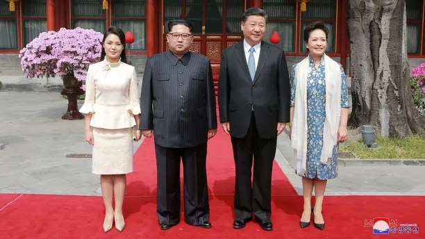 North Korean leader Kim Jong Un and wife Ri Sol Ju, and Chinese President Xi Jinping and wife Peng Liyuan pose for a photo in Beijing, China, in this undated photo released by North Korea's Korean Central News Agency (KCNA) in Pyongyang March 28, 2018. KCNA/via Reuters ATTENTION EDITORS - THIS IMAGE WAS PROVIDED BY A THIRD PARTY. REUTERS IS UNABLE TO INDEPENDENTLY VERIFY THIS IMAGE. NO THIRD PARTY SALES. NOT FOR USE BY REUTERS THIRD PARTY DISTRIBUTORS. SOUTH KOREA OUT. NO COMMERCIAL OR EDITORIAL SALES IN SOUTH KOREA. - RC1C51817800