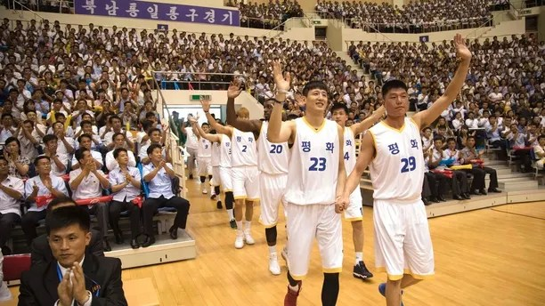 South and North Korean players of Team Peace wave as they arrive to play in their friendly basketball game at Ryugyong Jong Ju Yong Gymnasium in Pyongyang, North Korea, Wednesday, July 4, 2018. The rival Koreas on Wednesday began two days of friendly basketball games in Pyongyang in their latest goodwill gesture amid a diplomatic push to resolve the nuclear standoff with North Korea. Their uniforms read:
