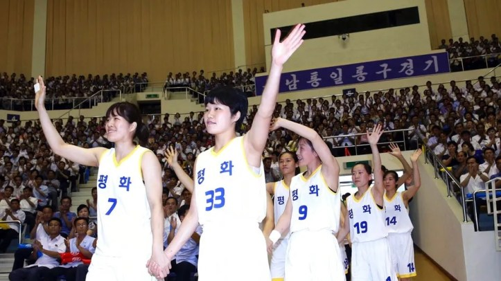 South and North Korean players of Team Peace wave as they arrive to play in a friendly basketball game at Ryugyong Jong Ju Yong Gymnasium in Pyongyang, North Korea, Wednesday, July 4, 2018.