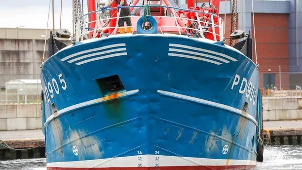 A view of the bow of Honeybourne III, a Scottish scallop dredger, in dock at Shoreham, West Sussex, Wednesday, Aug. 29, 2018 following clashes with French fishermen in the early hours of Tuesday morning in the English Channel during a long-running dispute over the scallop-rich area. French maritime authorities are appealing for calm after fishermen from rival French and British fleets banged their boats in ill-tempered skirmishes over access to the scallop-rich waters off France's northern coast. Maritime official Ingrid Parrot described a muscular confrontation between 35 French boats and five British ones in international waters on Tuesday morning as