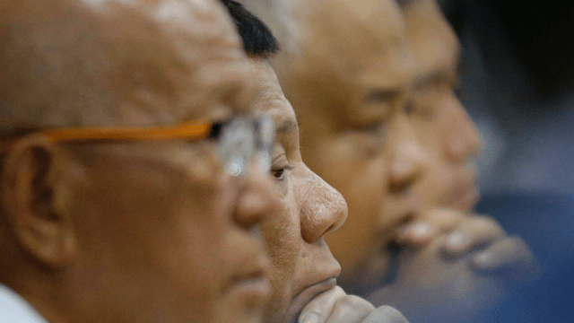 Philippine President Rodrigo Duterte, second from left, attends a command conference on Typhoon Mangkhut, locally named Typhoon Ompong, at the National Disaster Risk Reduction and Management Council operations center in metropolitan Manila, Philippines on Thursday, Sept. 13, 2018. Philippine officials have begun evacuating thousands of people in the path of the most powerful typhoon this year, closing schools and readying bulldozers for landslides. (AP Photo/Aaron Favila)