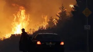 High wind gusts complicating wildfire fight.