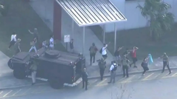 Police tell students and teachers to remain barricaded inside Marjory Stoneman Douglas High School in Parkland, Florida.