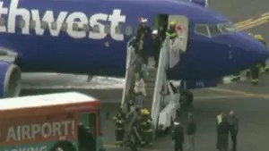 Southwest Airlines flight makes emergency landing in Philadelphia after a passenger was reportedly 'partially sucked out' an airplane window when an engine exploded in midair.