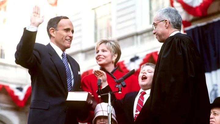 Rudolph Giuliani, alongside his then-wife Donna Hanover, is sworn in as 107th Mayor of New York City, 2nd January 1994. (Photo by Mark Peterson/Corbis SABA/Corbis via Getty Images)