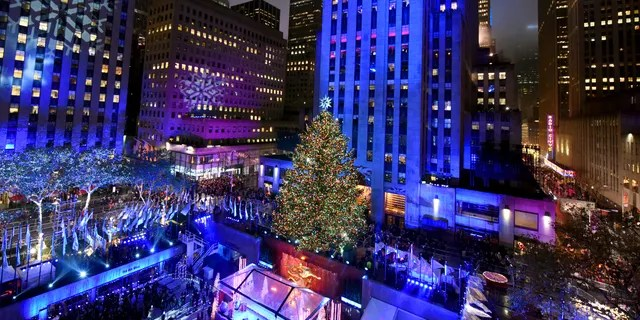 The Rockefeller Center Christmas Tree is lit at the 83rd Annual Rockefeller Center Christmas Tree Lighting Ceremony, Wednesday, Dec. 2, 2015 in New York. AP