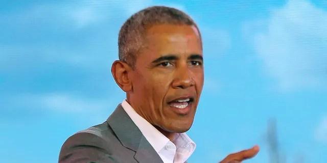 Former US President Barack Obama gestures to the crowd, during an event in Kogelo, Kisumu, Kenya, Monday, July 16, 2018.