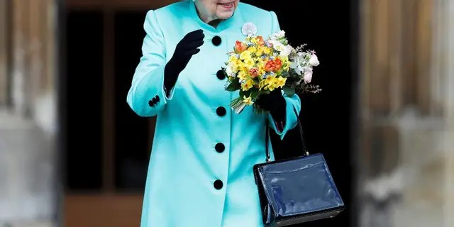 Britain's Queen Elizabeth waves to onlookers as she leaves the Easter Sunday service at St George's Chapel at Windsor Castle in Berkshire, England, Sunday, April 16, 2017. (Peter Nicholls/Pool Photo via AP)