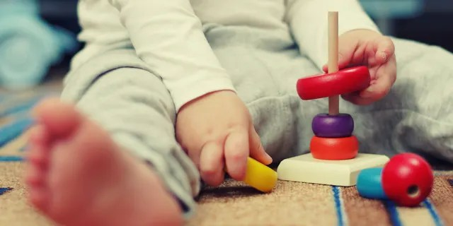 A baby plays with toys.
