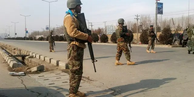 Afghan security forces keep watch at the site of an attack in Kabul, Afghanistan December 18 ,2017. REUTERS/Omar Sobhani - RC1BDDD0B8C0