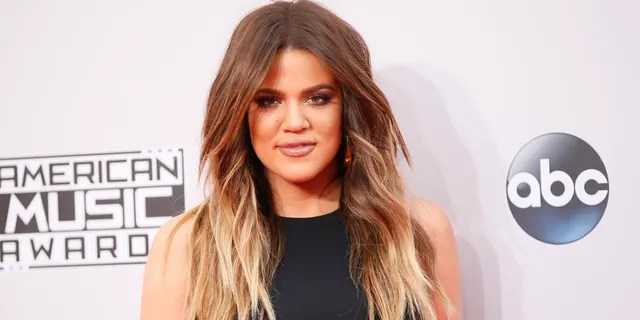 Khloe Kardashian and her 6-month-old daughter True stand with Khloe's brother, Rob, due to Woolsey Fire.