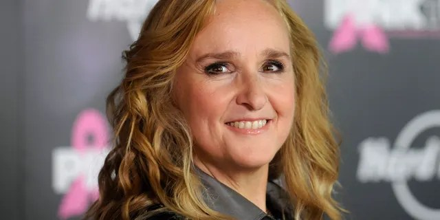 The singer Melissa Etheridge is in a hotel after evacuating her home due to a violent fire in Southern California.