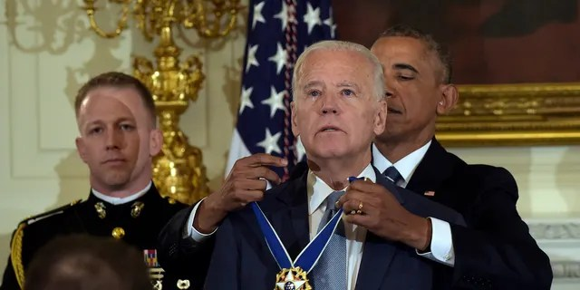 President Barack Obama presents Vice President Joe Biden with the Presidential Medal of Freedom on Jan. 12, 2017.
