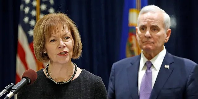 Smith, seen here with Minnesota Gov. Mark Dayton, was named to fill Al Franken's seat. (REUTERS/Eric Miller)