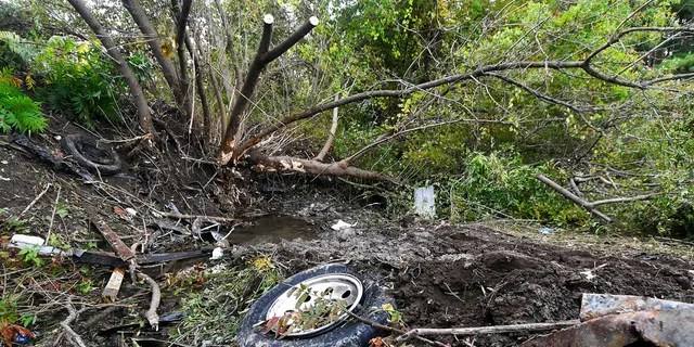 Debris scatters an area Sunday, Oct. 7, 2018, at the site of Saturday's fatal crash Schoharie, N.Y.