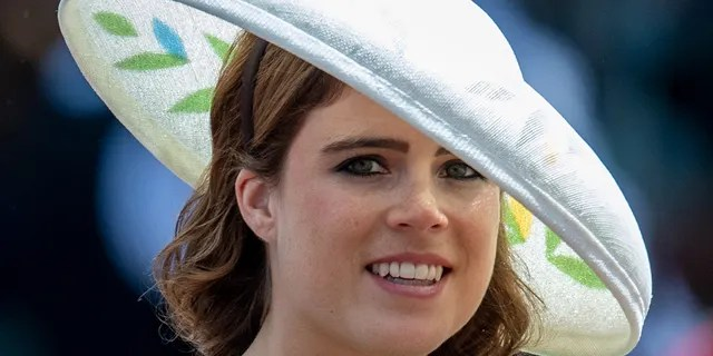 "Princess Eugenie has said a ""British-based designer"" is behind her wedding dress."