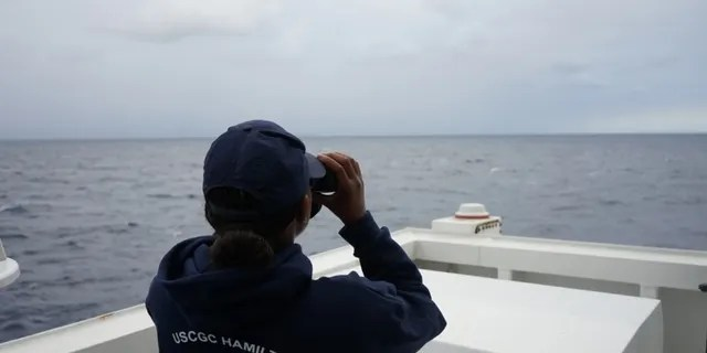 A Coast Guard Cutter Hamilton crew member searches for a downed civilian aircraft Oct. 27, 2018, 110 miles east of Charleston, South Carolina.