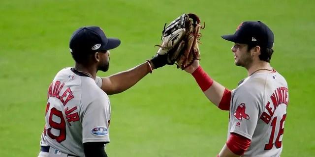 Boston Red Sox center fielder Jackie Bradley Jr., left, and left fielder Andrew Benintendi. The Red Sox have taken the series lead against the Houston Astros.