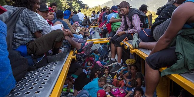 U.S.-bound Central American migrants riding on a truck that left Cordoba, Mexico, on Monday.