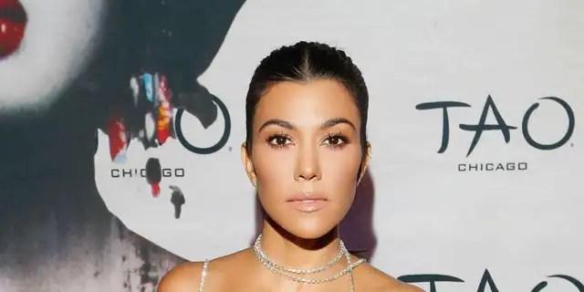 Kourtney Kardashian shares PDA pic in thong bikini with ...