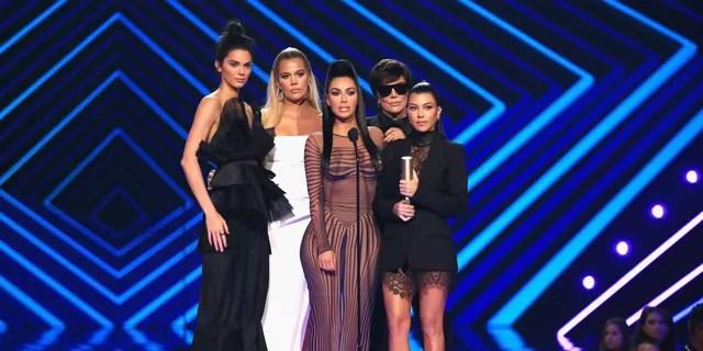 Kendall Jenner, Khloe Kardashian, Kim Kardashian West, Kris Jenner, and Kourtney Kardashian accept The Reality Show of 2018 award for 'Keeping Up with the Kardashians' on stage during the 2018 E! People's Choice Awards.