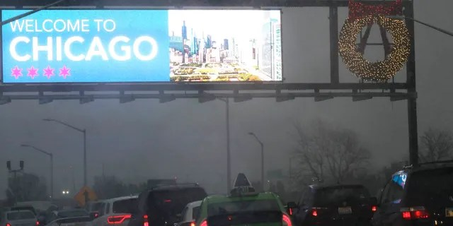 Heavy traffic is seen on an expressway near O'Hare International airport in Chicago, Sunday, Nov. 25, 2018.