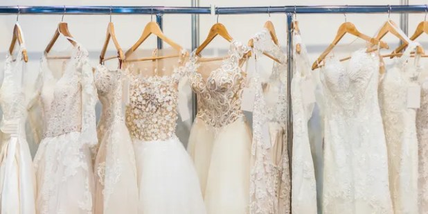 A bride is upset because her father's girlfriend is thinking of wearing a -f-white dress at her wedding.  (iStock)