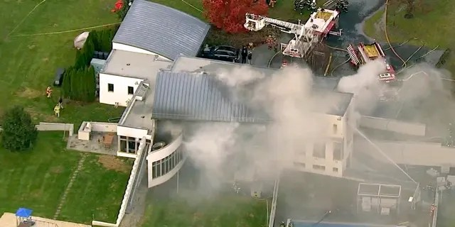 In this image made from a video provided by WABC firefighters battle a fatal fire on Tuesday, Nov. 20, 2018, in Colts Neck, N.J.