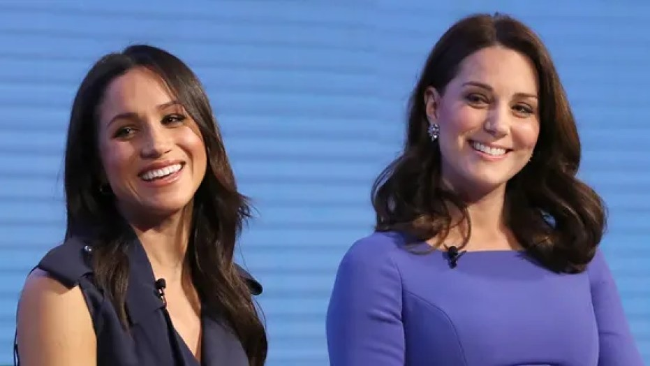 Meghan Markle (left) with Kate Middleton during happier times.