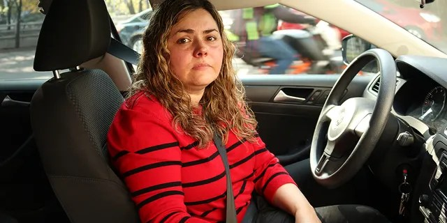 Martha Rodriguez waits to fill up in Mexico City