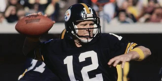 Pittsburgh Steelers' quarterback Terry Bradshaw prepares to throw a pass to one of his fellow teammates.