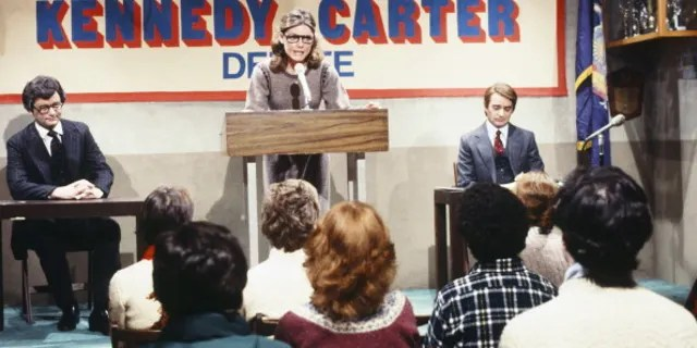 """Bill Murray as Ted Kennedy, Jane Curtin as moderator, Brian Doyle-Murray as Jody Powell during """"Kennedy-Powell Debate"""" skit on February 16, 1980. (NBC/NBCU Photo Bank via Getty Images)"""
