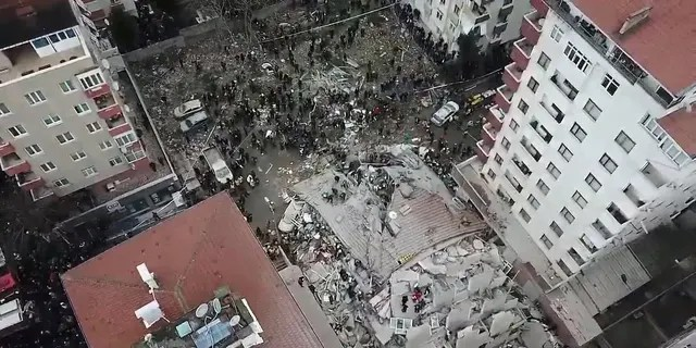This frame made from video shows the site where a seven-story building collapsed, in Istanbul, Wednesday, Feb. 6, 2019. A seven-story building collapsed in Istanbul on Wednesday, killing at least one person and trapping several others inside the rubble, Turkish media reports said.