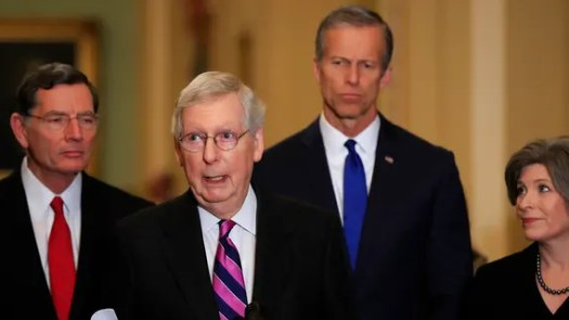 Senate Majority Leader Mitch McConnell, R-Ky., with, from left, Sens. John Barrasso, R-Wyo., McConnell, John Thune, R-S.D., and Joni Ernst, R-Iowa, speakING to reporters on Capitol Hill in Washington, Tuesday. (AP Photo/Manuel Balce Ceneta)
