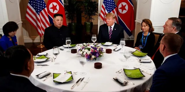 President Donald Trump speaks during a dinner with North Korean leader Kim Jong Un, Wednesday, Feb. 27, 2019, in Hanoi. Seated on right are acting White House Chief of Staff Mick Mulvaney, Secretary of State mike Pompeo and interpreter. Seated on left are North Korean Minister of Foreign Affairs, Ri Yong Ho and interpreter.