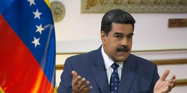 In this Feb. 14, 2019 file photo, Venezuela's President Nicolas Maduro speaks during an interview at Miraflores presidential palace in Caracas, Venezuela. (AP Photo/Ariana Cubillos, File)