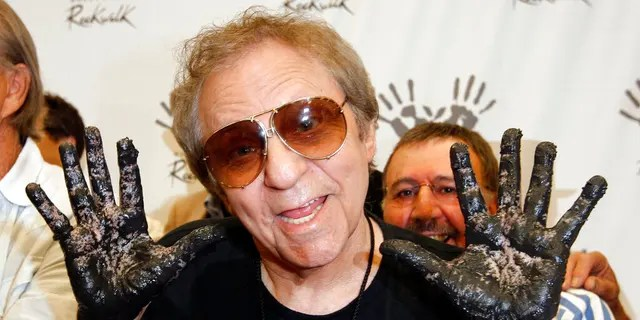 FILE: Hal Blaine holds up his hands covered in cement after placing them in wet cement with Don Randi and Glen Campbell, representing The Wrecking Crew following an induction ceremony for Hollywood's RockWalk in Los Angeles.